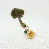 Ivory and emerald Sparkle gold flower fairy necklace on bronze chain