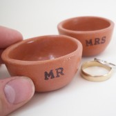 mr and mrs ceramic ring holders in red earthenware