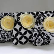 Mix and match black and white clutches