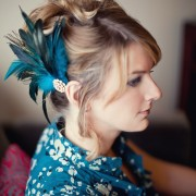 Feather fascinator in peacock tones