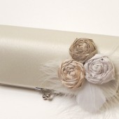 ivory bridal clutch with silk rosettes and feathers