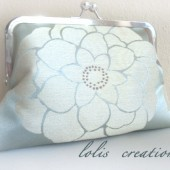 http://www.etsy.com/listing/65797069/silver-sky-ivory-flower-clutch-by-lolis