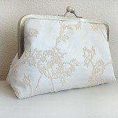 http://www.etsy.com/listing/72955974/ivory-caviar-beaded-clutch-by-lolis