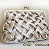 http://www.etsy.com/listing/55646883/bride-satin-clutch-8-inches-by-lolis