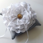 Grey wedding ring pillow with white lace flower