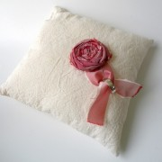 Cream muslin wedding ring pillow with red rosette