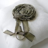 Off-white linen wedding ring pillow with sage rosette