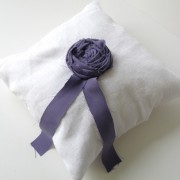 White linen wedding ring pillow with lilac rosette
