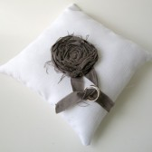 White cotton wedding ring pillow with dark grey rosette
