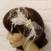 *  Jolanda netting and feather bridal hair fascinator