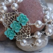 Triple Strand Pearl Bracelet with Aqua Flower