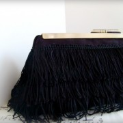 Black fringe clutch