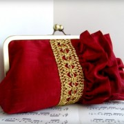 Dark red silk ruffled clutch