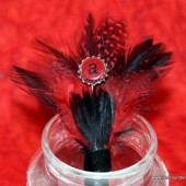 Red and Black Feather Boutonniere with Miniature Bottle Cap Monogram