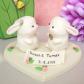 Bunny wedding cake topper with decorated wood stand