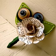 Green, and book page boutonniere