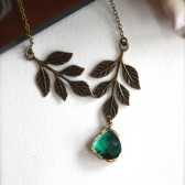 An Emerald Green Glass Jewel, Oxidized Brass Leaves Necklace
