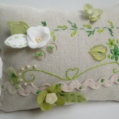 hand embroidered ring pillow in green