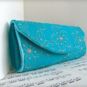 Teal blue clutch with flowers