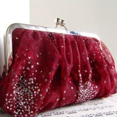 Dark red gathered clutch