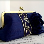 Navy blue silk clutch with ruffles