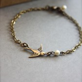 A Tiny Oxidized Brass Flying Swallow Bird with Swarovski Ivory Pearl Bracelet