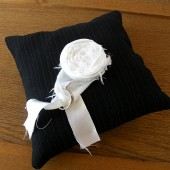 Black pinstripe weding ring pillow with white satin rosette