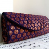 Navy and copper brocade clutch