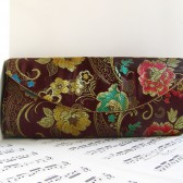 Brown brocade clutch