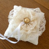 Cream cotton wedding ring pillow with lace flower