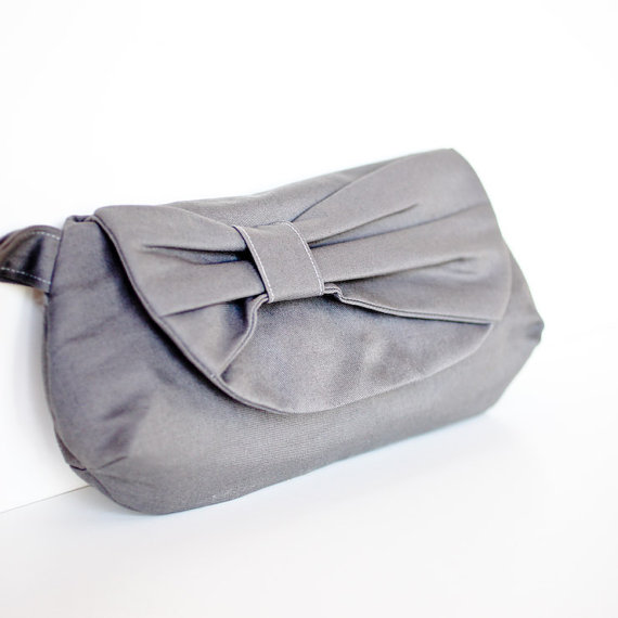 gray clutch with bow