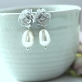 A Rhodium Plated Cubic Zirconia Flower Swarovski White Pearl Earrings.