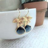 A Matte Gold Plated Orchid Flower Dark Sapphire Blue Glass Framed Jewel French Drop Earrings