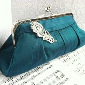 Peacock green silk clutch with brooch