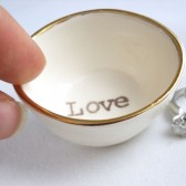 """white earthenware ring holder with gold luster rim, handprinted with \""""love\"""" text in your choose of custom case selection"""