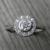 Round Forever Brilliant Moissanite Twig Halo Engagement Ring