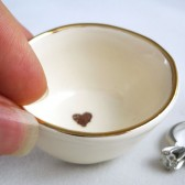 Red or Brown heart stamp inside a white earthenware clay ring holder with gold luster rim