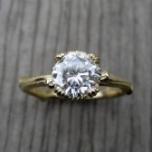 Round Forever Brilliant Moissanite Twig Engagement Ring, Carved Floral Setting (1ct)
