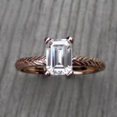 http://www.kristincoffin.com/products/emerald-forever-brilliant-moissanite-feather-engagement-ring-1ct