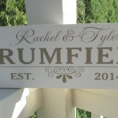 Wood sign with couple's names and established date