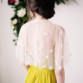 Capelet with floral accents