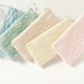 Bride and Bridesmaids lace clutches in pastel colors