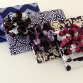 Purple Bridesmaid Clutches with Flowers