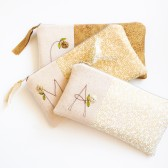 Monogram Gold Clutches