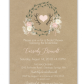 This unique Wedding Shower Invitation features a kraft background upon which sits a rustic floral wreath of baby's breath and blush flowers. Add in some deer antlers and handwritten calligraphy fonts and we're ready to shower the bride with love and good wishes!