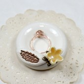 Golden feather ceramic wedding ring bowl