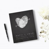 A traditional hard cover wedding guest book, featuring artwork made with your fingerprints.