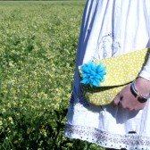 yellow clutch purse with teal chiffon flower