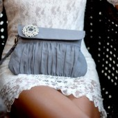 Grey linen clutch with rhinestone brooch