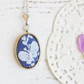 Textile necklace with blue butterfly lace and blue fabric